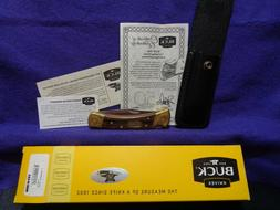 BUCK 110 50TH ANNIVERSARY KNIFE W/ SCROLLED BOLSTERS