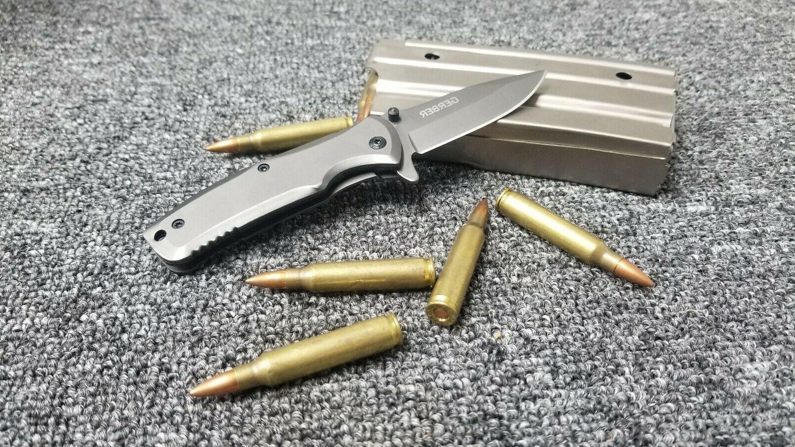 gray spring assisted covert folding pocket knife